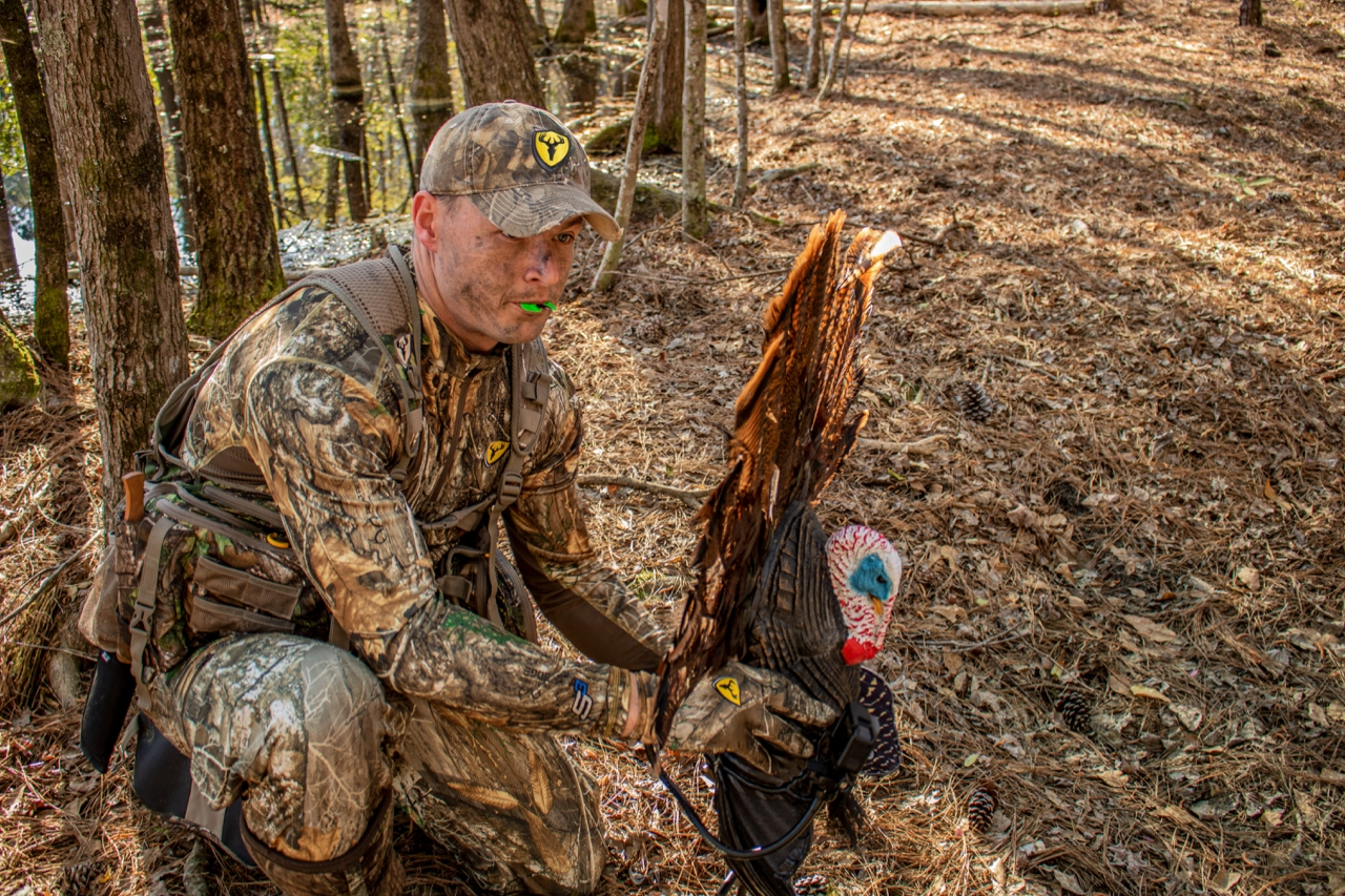 turkey hunter with turkey decoy and mouth call