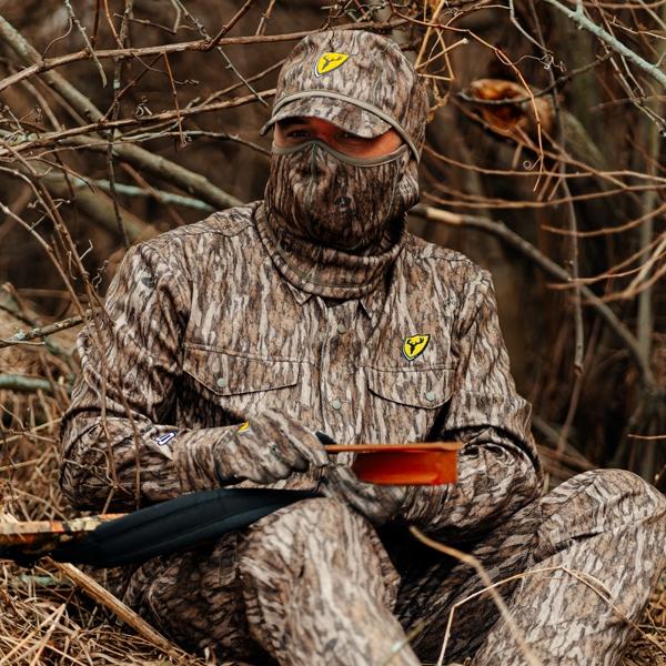 turkey hunter in mossy oak bottomlands shield series angatec shirt and pant