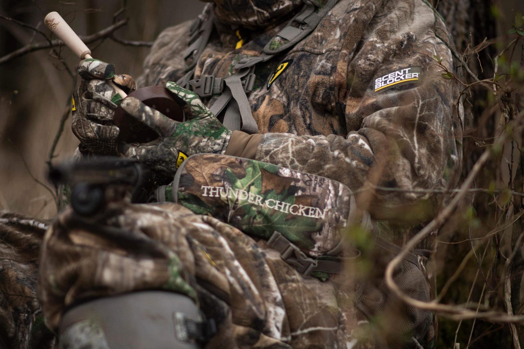 turkey hunter with strike call and turkey vest